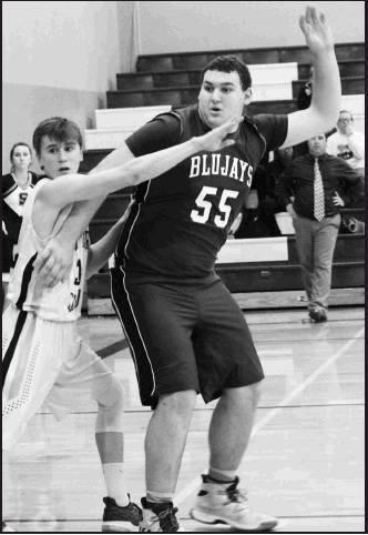 Dalton Schmitt No. 55 works on getting open for the Blujay pass against the Rock Hills defender.