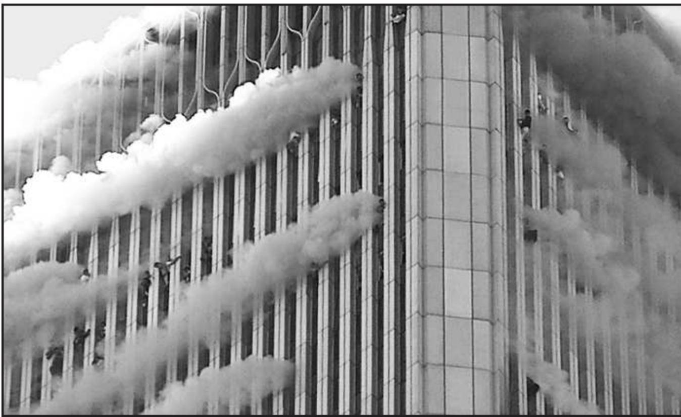 People hang from the windows of the North Tower of the World Trade Center after the 9.11, 2001 terrorists attacks. (2001 Getty Images)