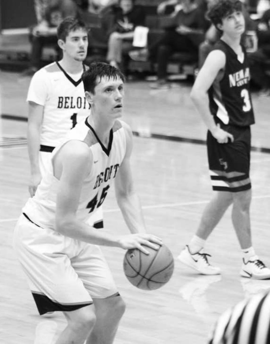 Beloit senior Bryce Mason makes his free shots for the Trojans during the first round of 3A State Championship competition in Hutchinson on Wednesday. Senior Vincent Palen is ready on the play. Trojan Times courtesy photo