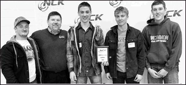 North Central Kansas Technical College President Eric Burks (second to left) congratulates the Beloit Team of Tate Ahlvers, Ryan Broeckelman, Cole Brummer, and Jacob Burks for a third place GMAW Invitational placing.