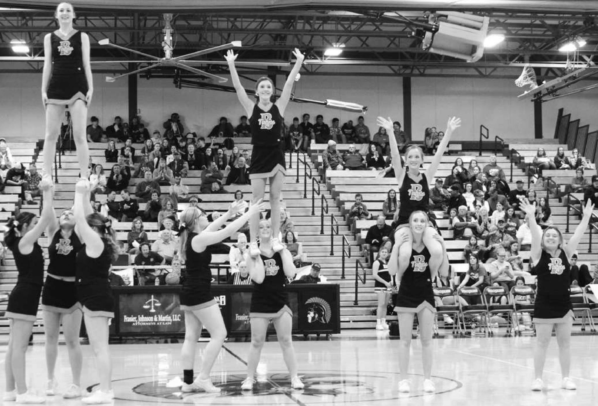 Beloit Cheerleaders, from left to right: Hannah Thiessen, Sage Schwerman, Niki Emerson, (Keighlee Armstrong atop), Ulexus Weaver, Darby Odle, (Kennedy Adams atop), Chloe Odle, Karody Kadel, and Taylor Monty cheer on their Beloit Trojans basketball teams i