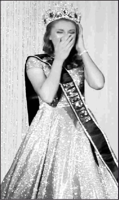Taysja Sevilla celebrates in disbelief as she is crowned the 2019 Pure International Young Miss America in Orlanda, Florida.