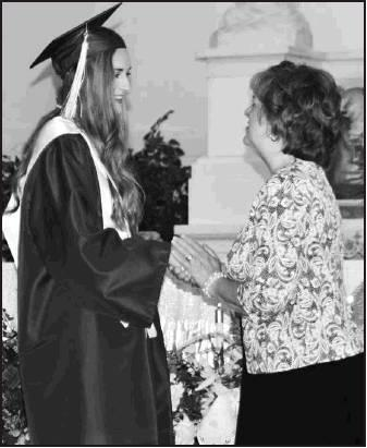 Sharon May presents Elle Eilert with her Gold Cord honor.