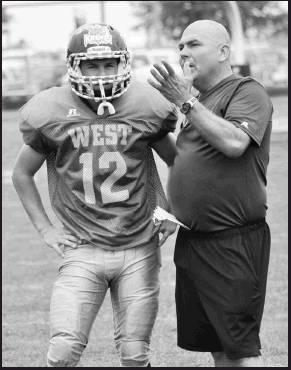 Coach Kresin talks with an All-Star 8-Man player during his coaching time during the 2014-15 year.