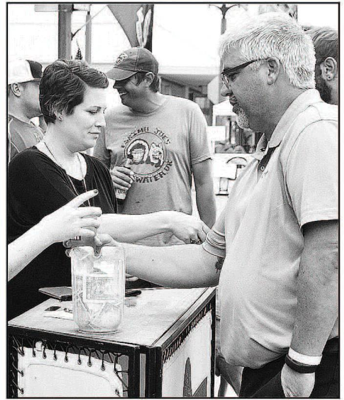 Mandy Fincham serves beverages during the street dance .