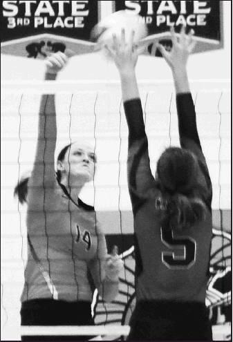 Sophomore Makenzie Travis No. 14 makes the block at the net for the Beloit Lady Trojans.