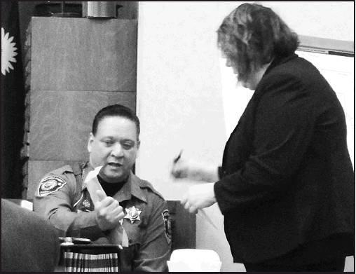 Sharon Sahlfeld photos Mitchell County Sheriff Tony Perez presents more evidence to Lincoln County Attorney Jennifer O'Hare during Monday's fifth trial day.