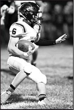 Senior Hudson Smith No. 6 on carries for Trojan gained yards.