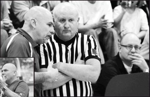 Coach Kresin talks with the referee during a 2016 basketball game as Father Damien watches on.