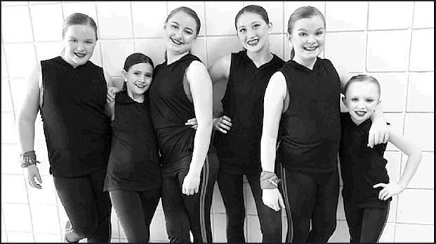 From left to right: Annika Wernecke, Peyton Pruser, Emma Herman, Megan Barr, Samantha Prescott, and Miley Kemmerer, coached by Kris Farmer, competed in the Bravo National Dance and Talent Competition in Wichita.
