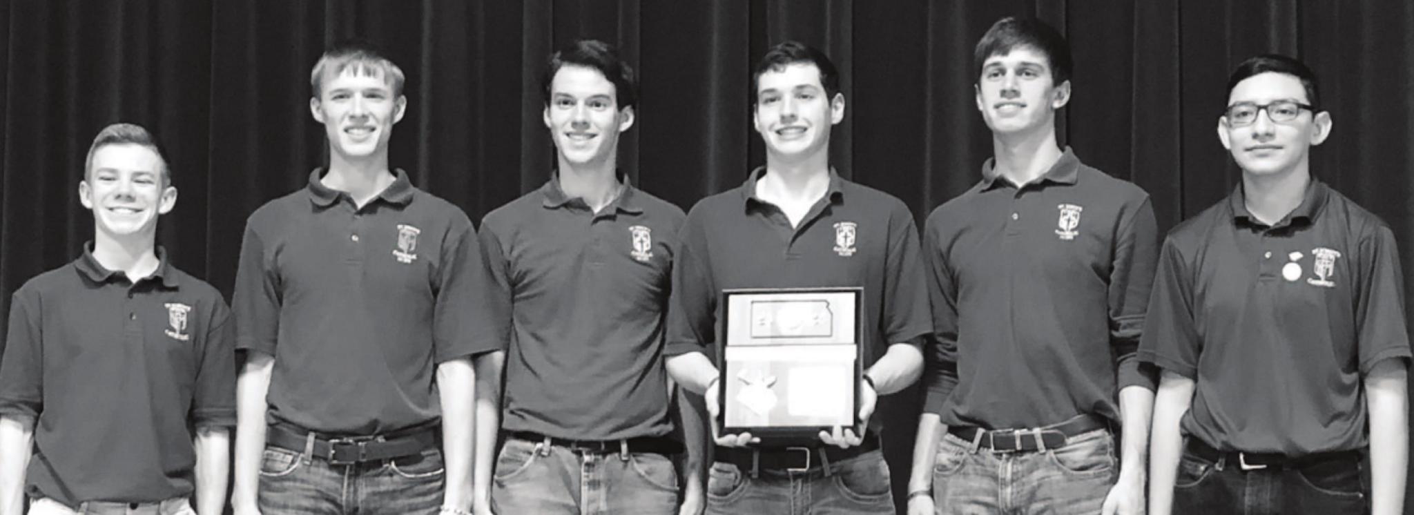 St. John's Scholars Bowl team are from left to right: Ben Thompson, Brandon Bates, Benjamin Walter, Jadyn Rosebaugh, Braden Dameron, Sergio Lopez.