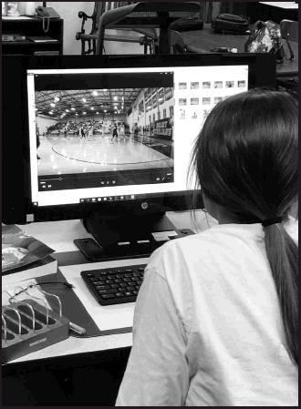 Students attend games and other school events to take photographs and learn how to use them for videos.