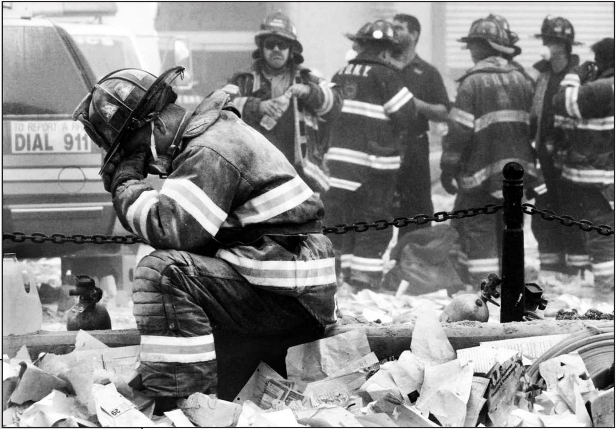 A firefighter breaks down after the World Trade Center buildings collapsed. (Getty images)