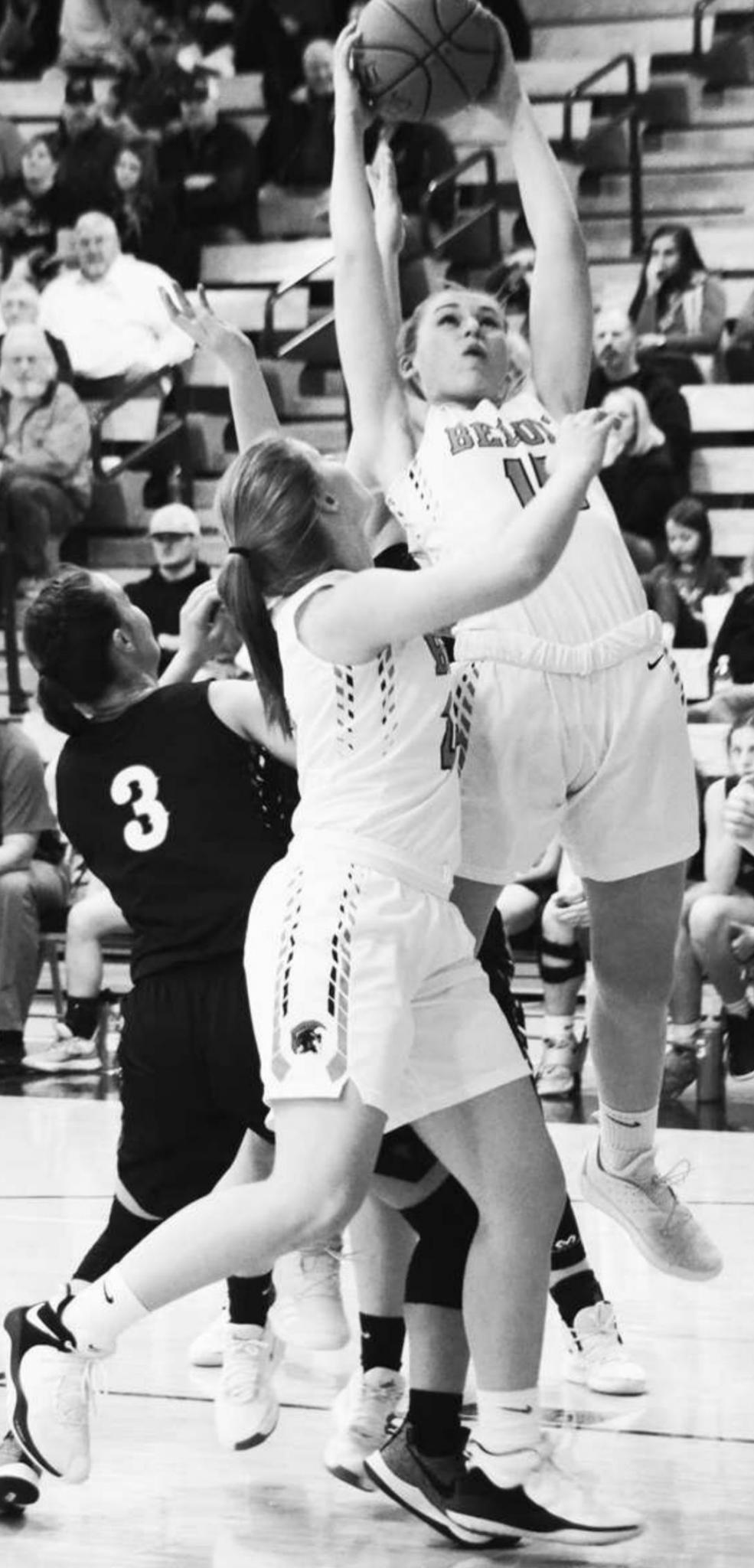 Shea Larson No. 15 and Porsche Cooper grab the rebounds for Beloit during a home game competition.