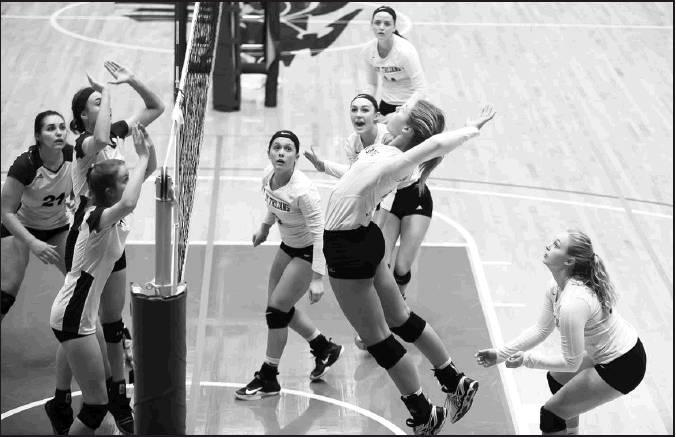Stephanie Meier courtesy photos Leading at the net on the season on kills, senior Shea Larson makes the attack for Beloit. Senior Jessica Meier, Trista Boeve, Darby Odle and sophomore MaKenzie Travis are ready on the play in State action volleyball.