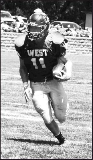 Chris Brent photos Drake Steinbrock of Clifton/Clyde No. 11 gains yards for the Division I West team.