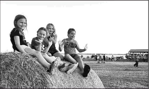 Friends enjoy their hay bale seating as they prepare to watch the Fourth of July Fireworks Display held in conjunction with the Lakefest celebrations held at Glen Elder State Park on Saturday. Over 500 people attended the event. Lucille Heller courtesy ph