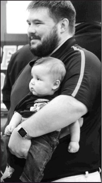 Sharon Sahlfeld photos          Assistant Coach Ryan Malay introduces his son Xander to the Beloit Wrestling family as Beloit opened their season at home on Friday, Nov. 30 with two dual wins.