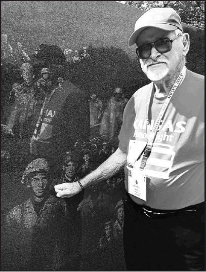 Bob Petterson notices his gunner who he called Hill, etched on the Korean Memorial Monument in Washington D.C. during the Kansas Honor Flight. This was a bittersweet moment for Petterson.