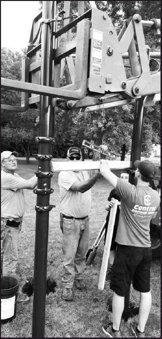 Chris Bell, Tim Bell, Ethan Anderson and Nick Jensen work on erecting the new playground equipment.