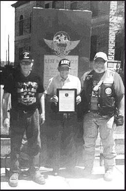 Above left: Loren Havey (middle) receives a plaque from the American Legion Riders on behalf of Beloit Post 57 and their participation in the 'Riding for the Children of Fallen Soldiers' program.