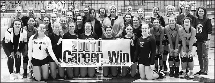 The Beloit Lady Trojans volleyball team are now 20-1 overall, 8-0 in the league after their Tuesday win over Southeast of Saline and Head Coach Brandy Paul's 200th career win. Shown celebrating the moment are from left to right, front row: Seniors Jaimi