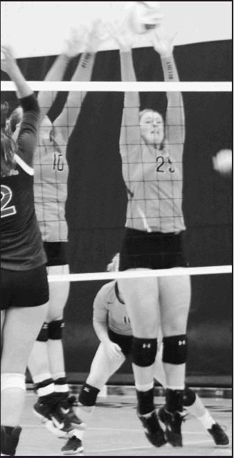 Sydney Barrett No. 10 and Paige Goddard No. 25 team up for the blocks at the net for Beloit.