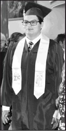 Victor Ayala walks the aisle to receive his diploma.