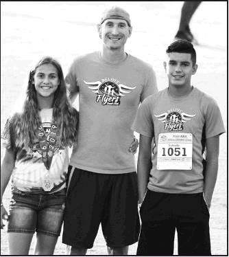 Above: Beloit Flyers Youth Track Club, under the direction of Coach Chad Lorenz, qualified Autumn Lorenz and Armando Salcido for the AAU Jr. Olympics in Greensboro, North Carolina. Left: Lorenz placed 8th for a National spot on the podium in the turbo jav