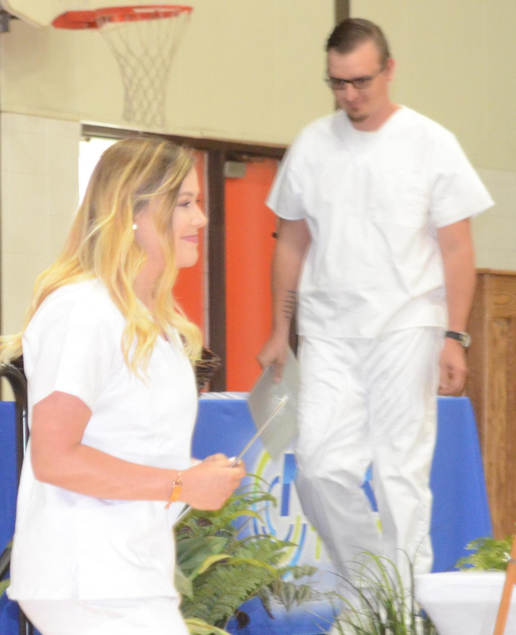 Meghan Augustine and Justin Towery receive $500 Scholarships from S&S Drug in Beloit.