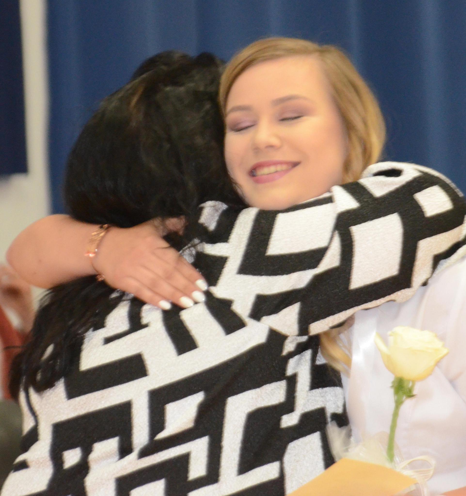 Sharon Sahlfeld photo Meghan Augustine receives a hug from North Central Kansas Technical College Nursing Director, Sandy Gottschalk after receiving her pin during graduation ceremonies, held on Friday at the Beloit Jr/Sr High School.