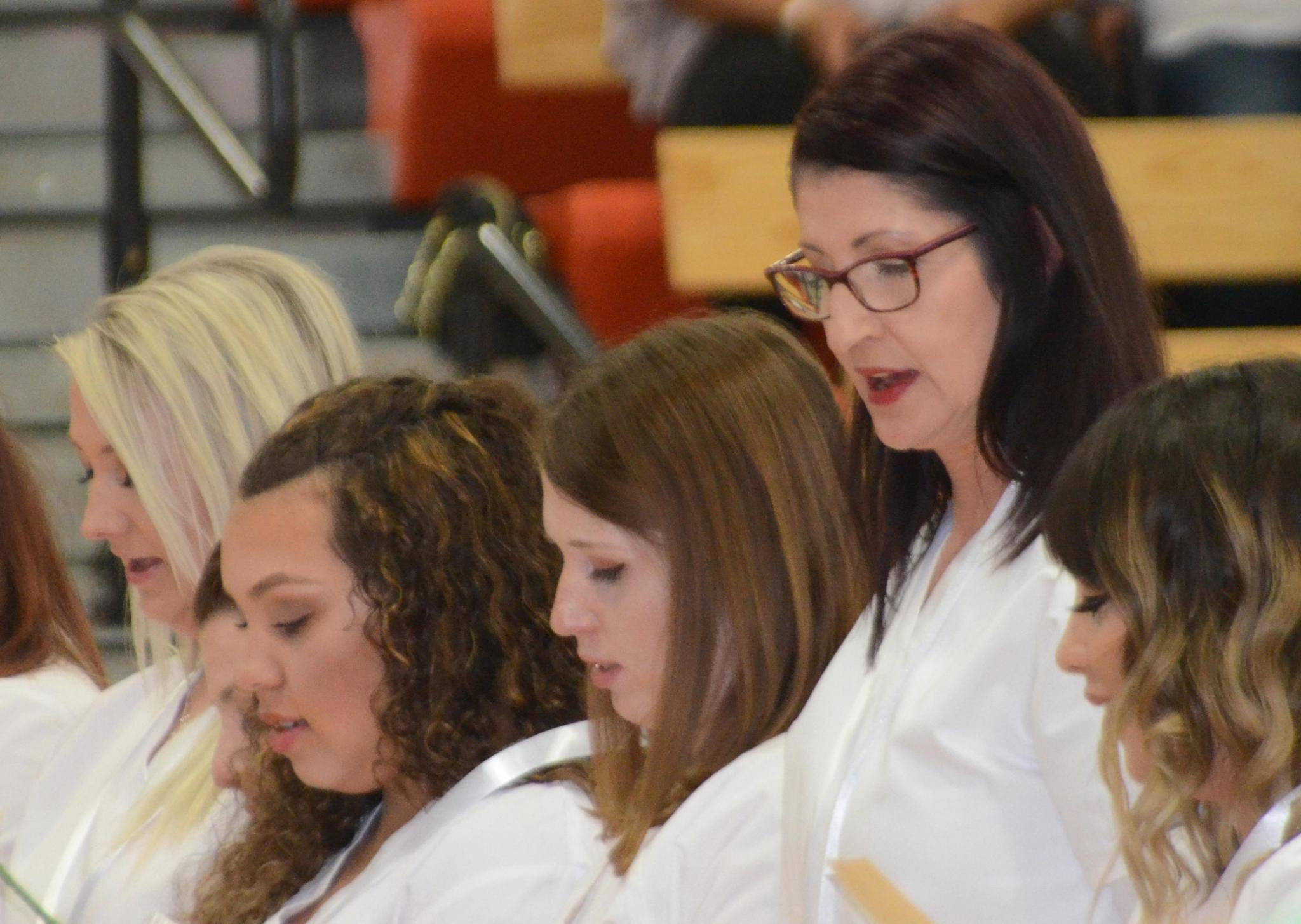 Nurses recite the Florence Nightingale Oath during the North Central Kansas Technical College nurses pinning ceremony. Karen Finney (Second to the right) of Beloit, received the Mitchell County Regional Medical Foundation $500 Scholarship.