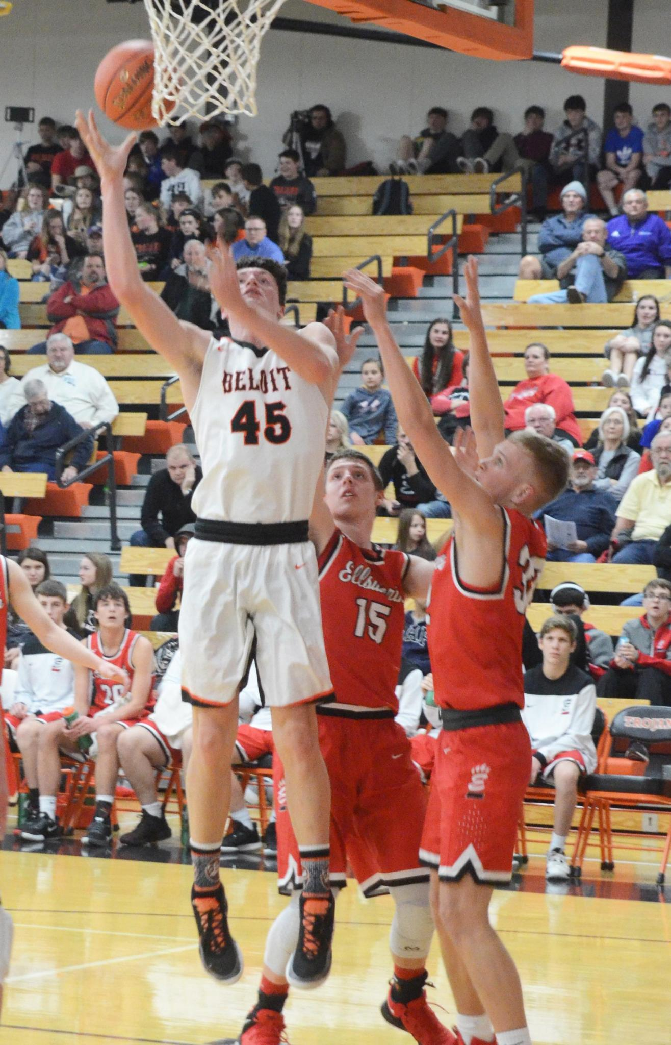 Beloit senior Bryce Mason No. 45 lands the shot for the Trojans in his 10 point, 8 rebound game against Ellsworth.